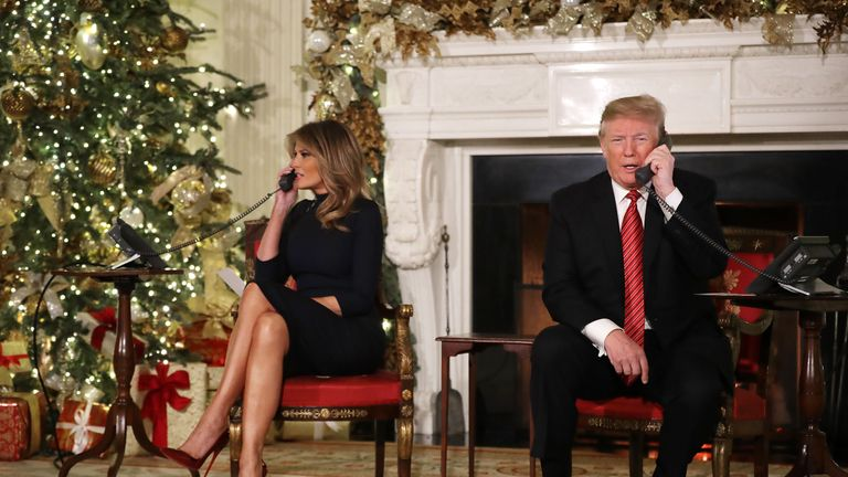 Melania and Donald Trump take calls from children on Christmas Eve