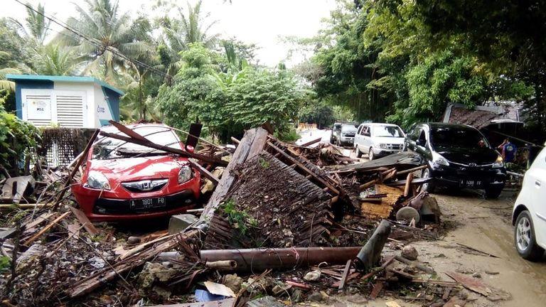 A damaged vehicle is seen amid wreckage from buildings along Carita beach on December 23, 2018, after the area was hit by a tsunami on December 22 following an eruption of the Anak Krakatoa volcano