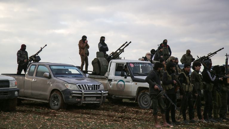 Turkish-backed Syrian fighters gather outside Manbij