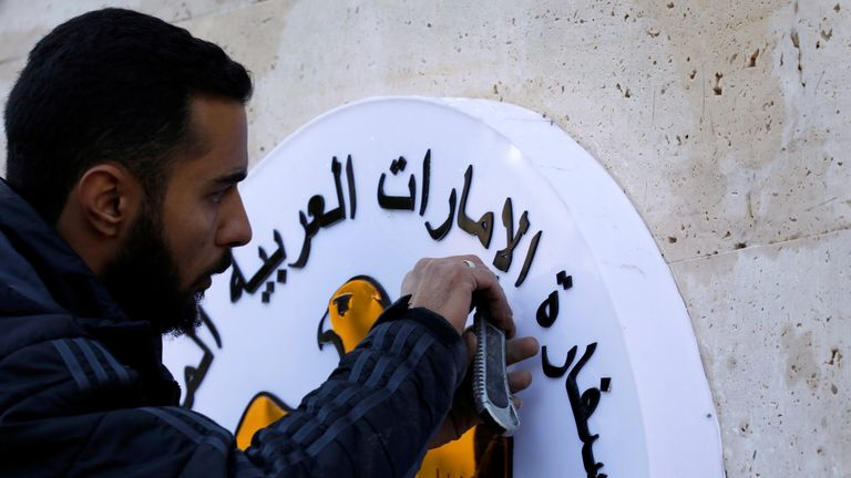 A man works on the United Arab Emirates embassy emblem during its reopening in Damascus, Syria December 27, 2018. REUTERS/Omar Sanadiki
