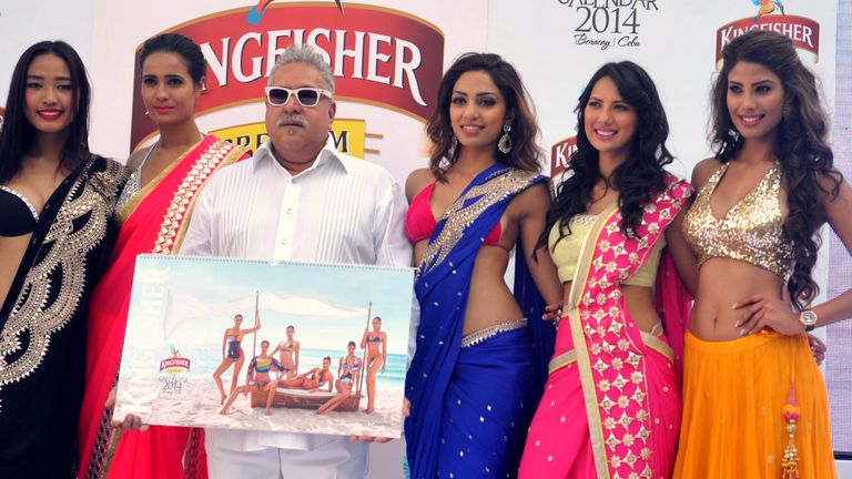 Vijay Mallya posing with models at hte launch of the Kingfisher beer 2014 calendar