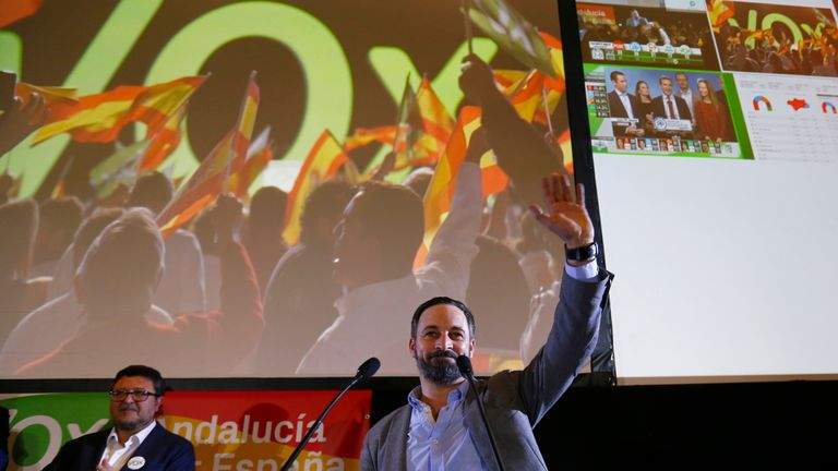 Vox party leader Santiago Abascal waves as he celebrates the results