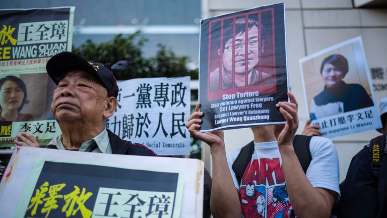 Activists hold placards of detained Chinese human rights lawyer Wang Quanzhang and his wife Li Wenzhu