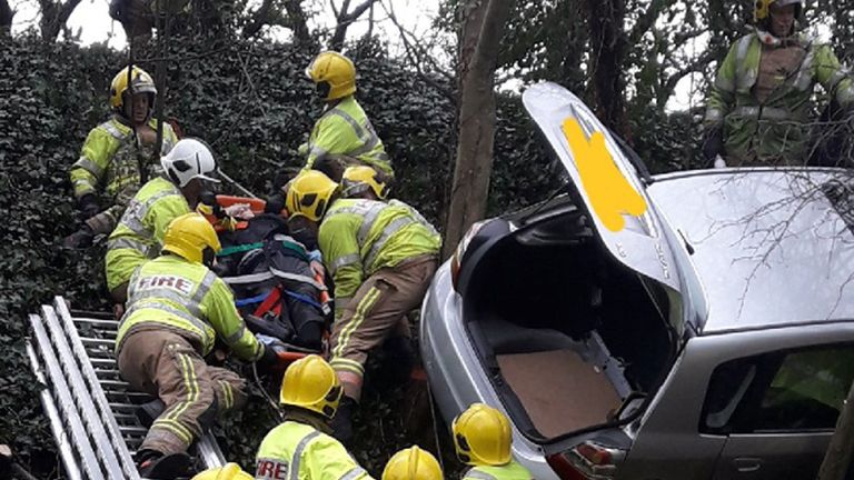 The couple, in their 80s, were rescued by emergency workers following the accident