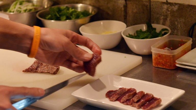 This picture taken on October 1, 2015 shows chef Eiichi Tsuchiya preparing whale meat carpaccio at his restaurant in Tokyo for the Ebisu whale meat festival