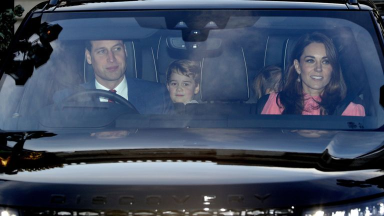 The Duke of Cambridge, Prince George and the Duchess of Cambridge leaving the Queen's Christmas lunch at Buckingham Palace