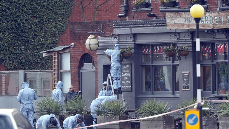 Forensics teams at a nearby pub after the operation