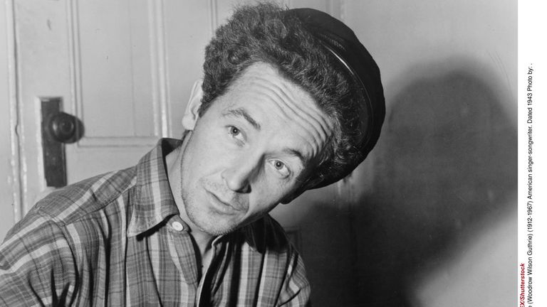 Portrait photograph of Woody Guthrie (Woodrow Wilson Guthrie) (1912-1967) American singer-songwriter. Dated 1943