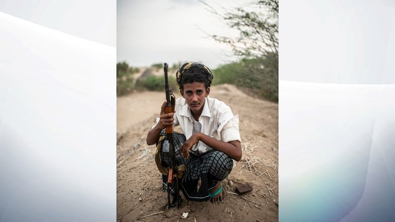 A fighter with the Tahami Resistance, a militia aligned with Yemen's Saudi-led coalition-backed government, sits at a frontline east of the city in Hodeidah, Yemen