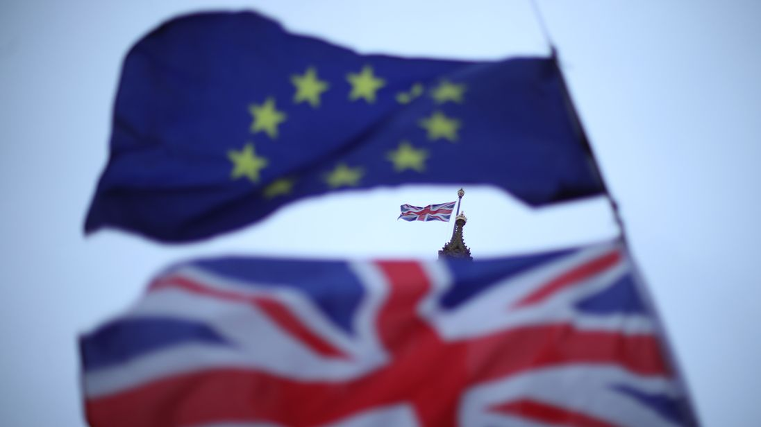 The EU and Union flags flying outside Parliament in Westminster