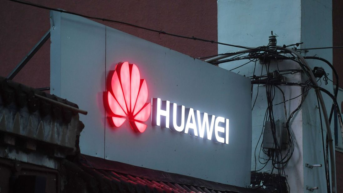 6 2018 shows a Huawei sign outside a store selling mobile phones in Beijing.- Despite being essentially barred from the critical US market Huawei surpassed Apple to become the world's number two smartphone maker in the