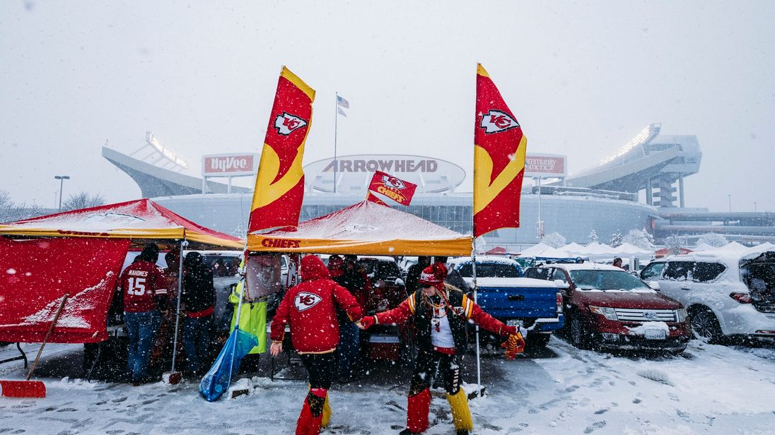 Kansas City Chiefs fans dance in a snow-filled parking lot while tailgating prior to the AFC Divisional Round playoff game between the Kansas City Chiefs and the Indianapolis Colts at Arrowhead Stadium on January 12, 2019 in Kansas City, Missouri