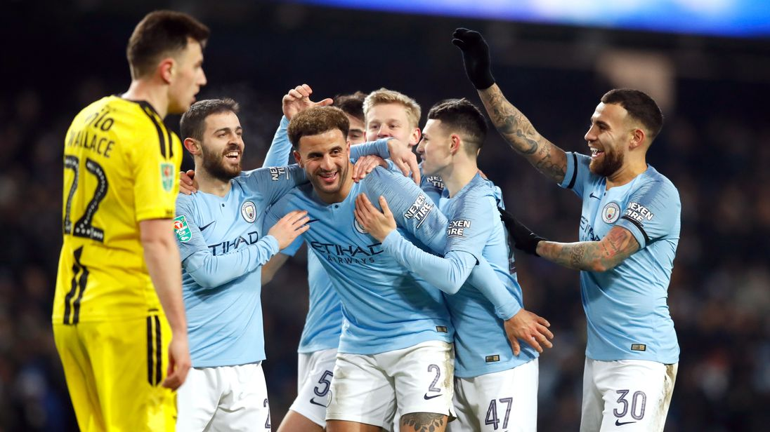 Manchester City players celebrate their eighth goal against Burton