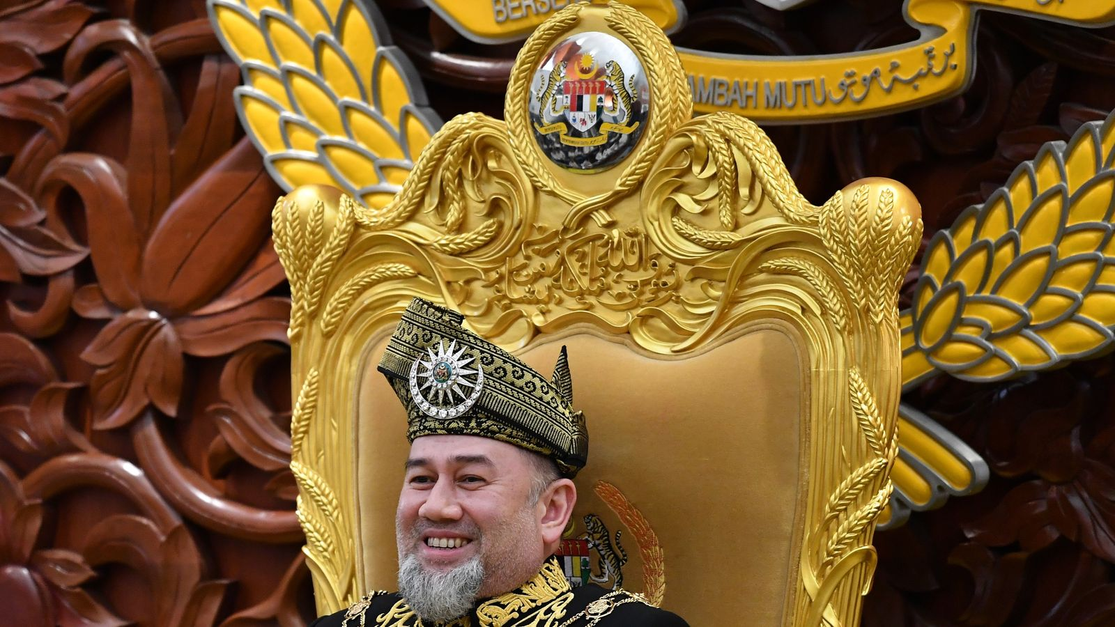 Malaysian king abdicates amid rumours of marriage to model