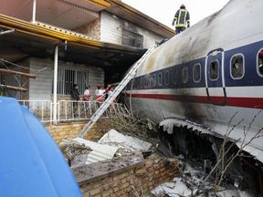 The plane crashed into the side of a house