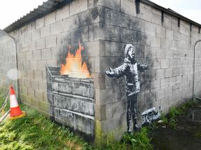 Artwork by street artist Banksy, which has appeared on a garage wall in Port Talbot