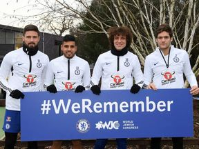 Chelsea players holding up a #WeRemember slogan. Pic: Chelsea.com