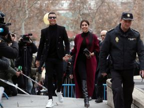 Cristiano Ronaldo arrives with his girlfriend Georgina Rodriguez to appear in court on a trial for tax fraud in Madrid