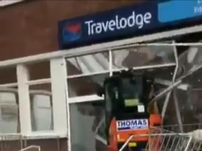 The digger was driven into the front of the Travelodge. Pic: Twitter/@joefblue