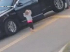 The girl emerged from the truck and gestured as though she was surrendering to the armed officers