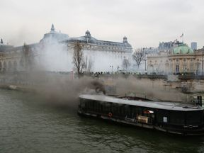 A river boat restaurant was set alight