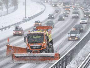 A snow plough clears the A9 highway in Garching, southern Germany