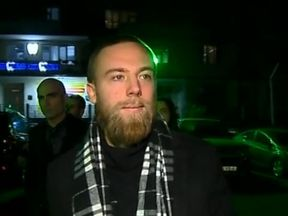 Jack Shepherd walking into a police station in Georgia