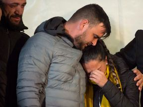 Parents of two-year-old Julen Rosello hug in Totalan, southern Spain, on January 24, 2019