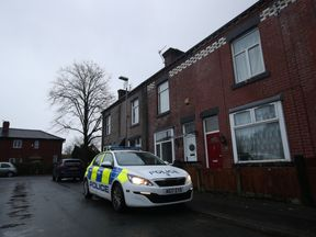 Police at a house in Arthur Street, Little Lever, Bolton