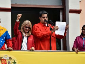 Maduro with his wife Cilia Flores, vice president Delcy Rodriguez and Diosdado Cabello address supporters
