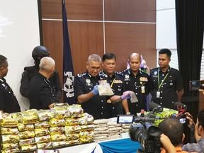 Mohamad Fuzi Harun displays the haul at a press conference