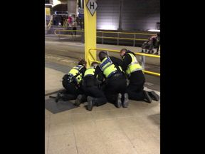 Officers arrest a suspect at Manchester Victoria Station. Pic @Clack_Sam