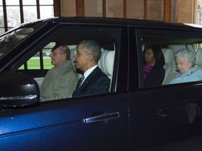 Prince Philip driving the Obamas and the Queen into Windsor Castle on the president's state visit in 2016