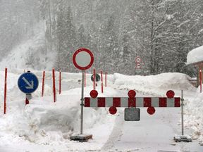 A road is blocked due to avalanche danger near Balderschwang, southern Germany