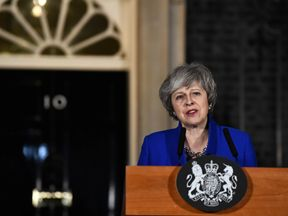 Theresa May makes a statement following winning a confidence vote, after Parliament rejected her Brexit deal, outside 10 Downing Street