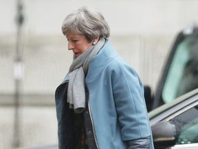 Theresa May returns to Downing Street