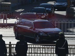 Kim Jong Un's motorcade leaves Beijing railway station