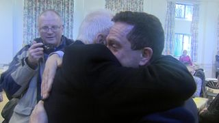 Crash survivor Leslie Bloomer (R) is reunited with retired police sergeant Bob Salter who was first on the scene