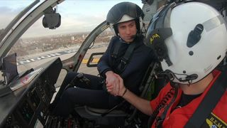 Prince William after landing a helicopter at the Royal London Hospital