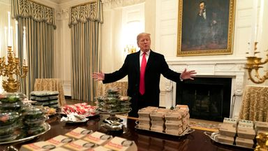 Trump serves fast food to football team