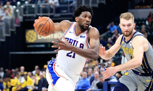 Joel Embiid battles through apparent back injury to lead Philadelphia 76ers to emphatic win over Indiana Pacers