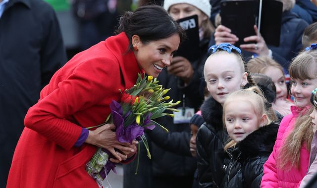 'That's a great name!' Meghan welcomes idea for baby as she visits Birkenhead with Harry