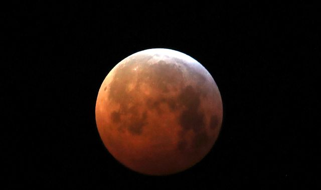 Rare super blood wolf moon makes early morning appearance