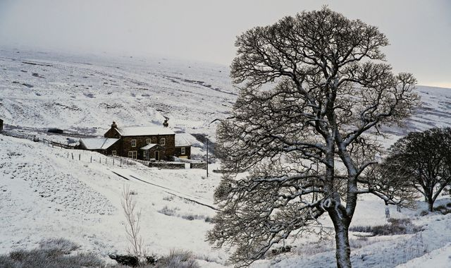Flights cancelled and ice warnings as snow falls across UK
