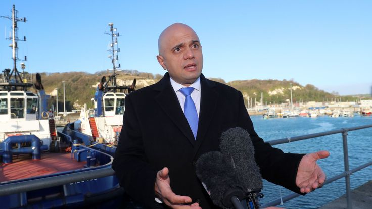 Britain's Home Secretary Sajid Javid speaks to members of the media after meeting with UK Border Force staff on the quayside at Dover, in south-east England on January 2, 2019
