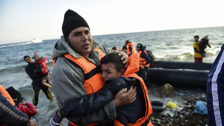 People reach the Greek island of Lesbos in 2015