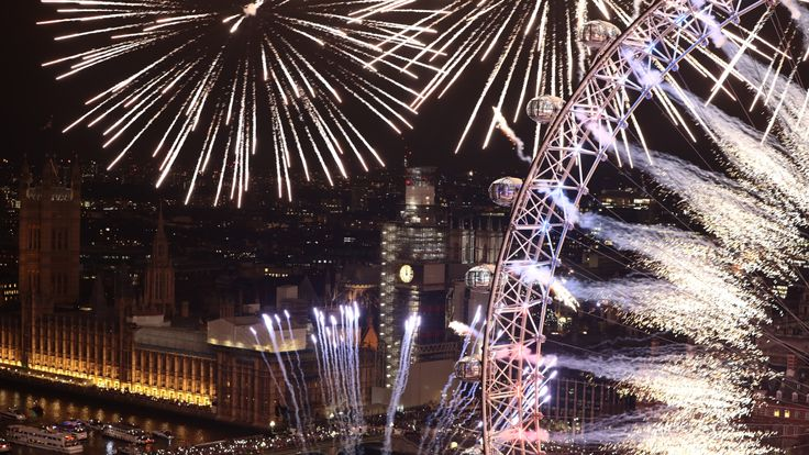 Fireworks explode over The London Eye and Elizabeth Tower near Parliament as thousands of revelers gather along the banks of the River Thames to ring in the New Year on January 1, 2019 in London, England. Parliament confirmed that after being silenced for renovation work since 2017, Big Ben's famous bongs would ring out at midnight again to welcome in 2019