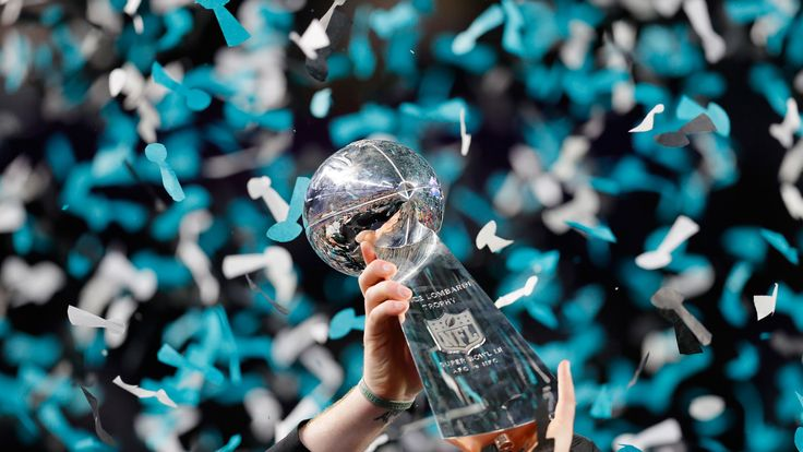 The Vince Lombardi Trophy is held aloft after Super Bowl 52