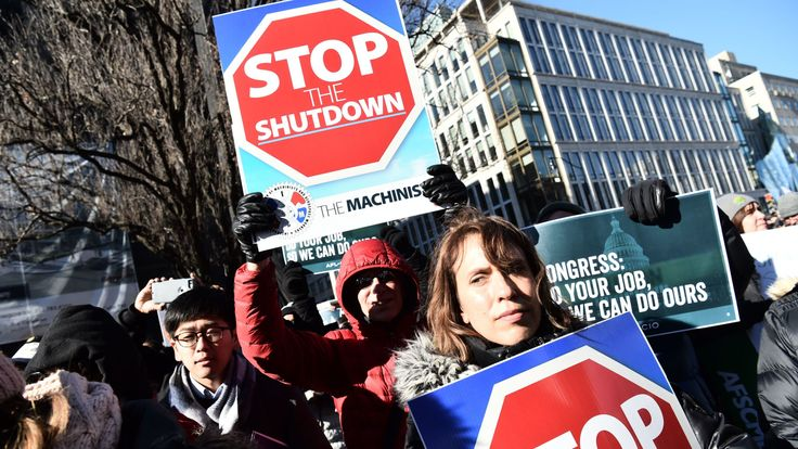 Union workers demonstrate against the government shutdown