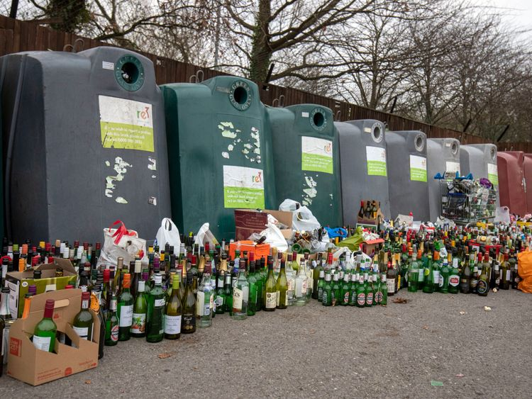 Rows of empty spirit, beer and wine bottles at a recycling centre near Bracknell